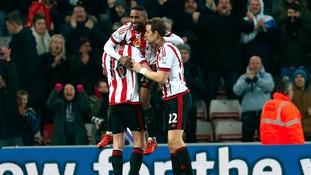 Sunderland's Jermain Defoe (centre) celebrates scoring his side's third goal of the game.