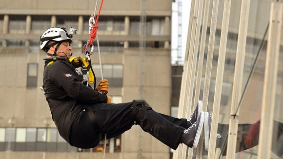 Prince Andrew pictured abseiling down The Shard.