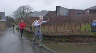 Joggers take part in the Fun Run in the rain