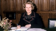 Margaret Thatcher wearing one of the outfits due to go under the hammer as she works in the House of Commons