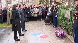 President Francois Hollande honours the victims of last January's Paris terror attacks