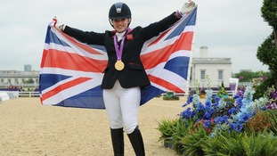 Natasha Baker pictured after winning her first gold in g the Dressage Individual Championship Test Grade II on Saturday