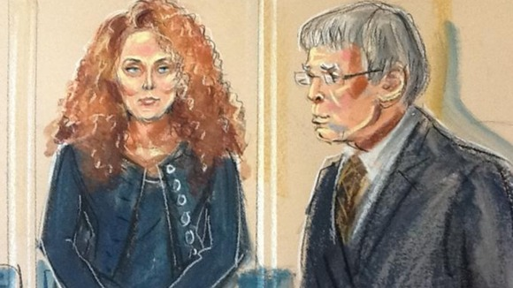 Artist&#x27;s impression of Rebekah Brooks and District Judge Howard Riddle 