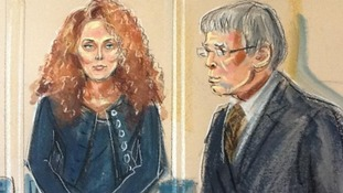 Artist's impression of Rebekah Brooks and District Judge Howard Riddle