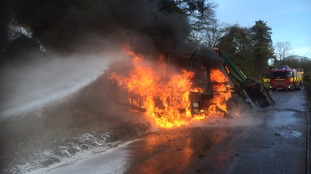 The tractor in flames this morning.