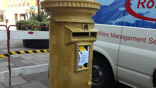 Paint dries on Ellie Simmonds gold post box in Walsall