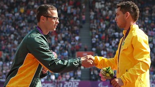 Oscar Pistorius shakes hands with gold medalist Alan Fonteles Cardoso Oliveira today at the Olympic Stadium