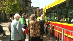 15 protesters board a bus to the Civic Centre
