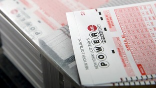 Powerball lottery jackpot rolls over to record-breaking $675 million