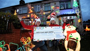 Couple raise thousands for children's charity through Christmas display
