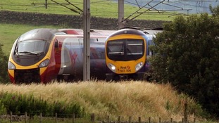 Two Virgin trains on the West Coast Main Line