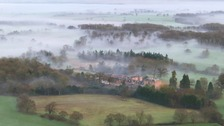 Aerial picture of mist and fog over Norfolk and Suffolk countryside.