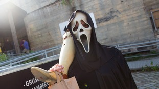 Person in a scream mask