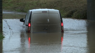 A van is stuck in flood water at Great Plumstead near Norwich.