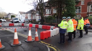 Sink hole closes road in Neath