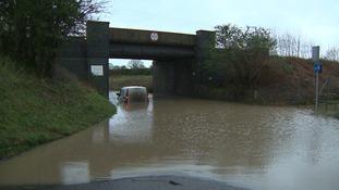 A van is stranded in flood water under the railway bridge at Gt Plumstead near Norwich.