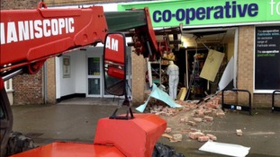 Thieves use digger to rip cash machine out of supermarket