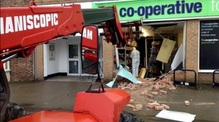Pictures show a cordoned-off section of the pavement littered with rubble from the damaged shop.