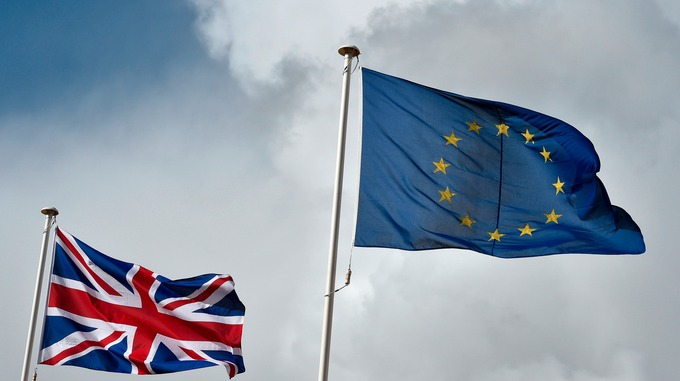 Union flag flutters next to the EU flag