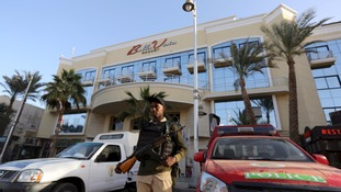 An Egyptian security member stands guard outside the hotel.