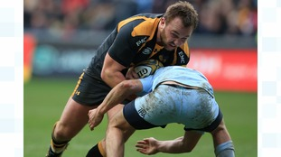 Wasps' Matt Mullen is tackled by Worcester Warriors' Charlie Mulchrone
