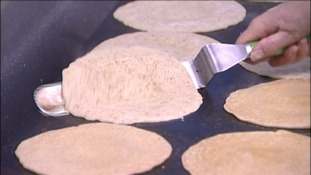 Oatcakes being flipped in the Hole in the Wall