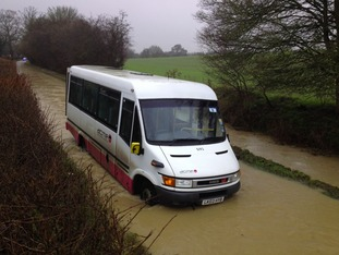 The bus became stranded in flood water at Mill Hill in Farnham, Essex after the engine cut out.