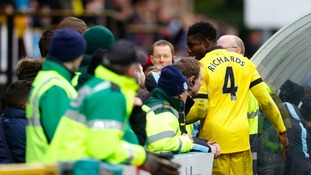 Aston Villa's Micah Richards (right) has an altercation with Aston Villa supporters in the crowd