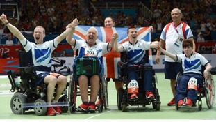 Daniel Bentley, Nigel Murray, David Smith and Zoe Robinson celebrate winning bronze during the Boccia mixed team BC1-2 bronze medal match