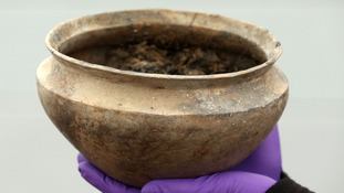 A pot recovered from a Bronze Age settlement destroyed in a fire 3,000 years ago, at Must Farm quarry in Cambridgeshire