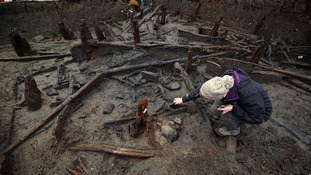 Archaeologist Selina Davenport works on the site of a Bronze Age settlement destroyed in a fire at Must Farm quarry in Cambridgeshire.