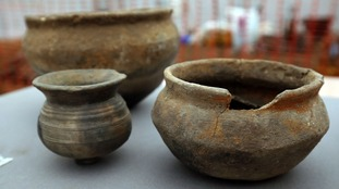 Pots recovered from a Bronze Age settlement destroyed in a fire 3,000 years ago, at Must Farm quarry in Cambridgeshire