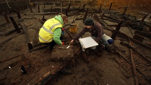 Archaeologists work on the site of a Bronze Age settlement destroyed in a fire 3,000 years ago.