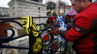 People placed German football scarves near the scene of the bombing.