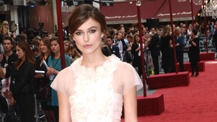 Keira Knightley walks the red carpet in London.