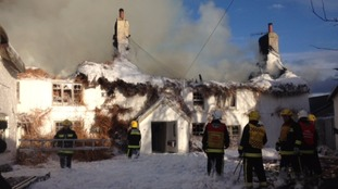 The thatch roof of the Ring of Bells Inn in Dartmoor set alight just before midday.