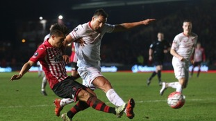 Exeter City's Tom Nichols and Liverpool's Jose Enrique battle for the ball.