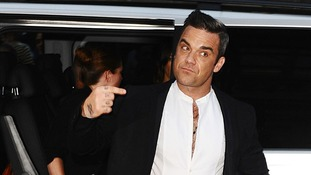 Robbie Williams arrives at the awards.