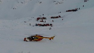 A helicopter rescue team are searching for those swept away in the avalanche.