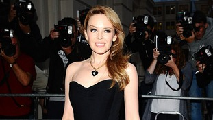 Music star Kylie arrives at the awards bash.