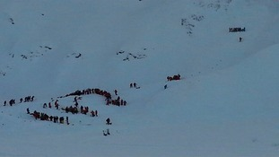 An Ukranian skier and 14-year-old boy have died in the avalanche.