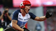 Great Britain&#x27;s David Weir pumps his fist after winning gold in the men&#x27;s 1500m T54 final.