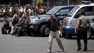 Armed police watch on during the siege in Jakarta.