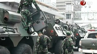 Armed forces are seen with tanks in the city centre.