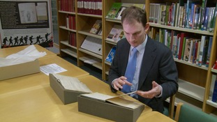Richard Hunt from Peterborough library looks through the station visitor books.