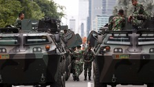 Military vehicles on the streets of Jakarta after the attacks.