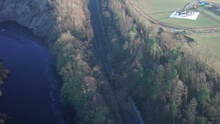 Engineers hope major rail line blocked by landslide will reopen in a month