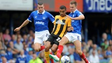 James Dunne (left) in action for Portsmouth against Cambridge United.