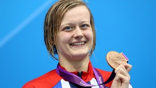 Great Britain's Hannah Russell on the podium after winning the bronze medal in the Women's 100m Butterfly.