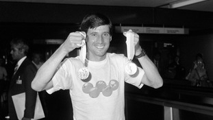 Coe shows off his gold and silver medals after the 1984 Los Angeles Olympic Games